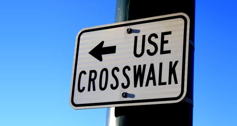 Use crosswalk - do not jaywalk