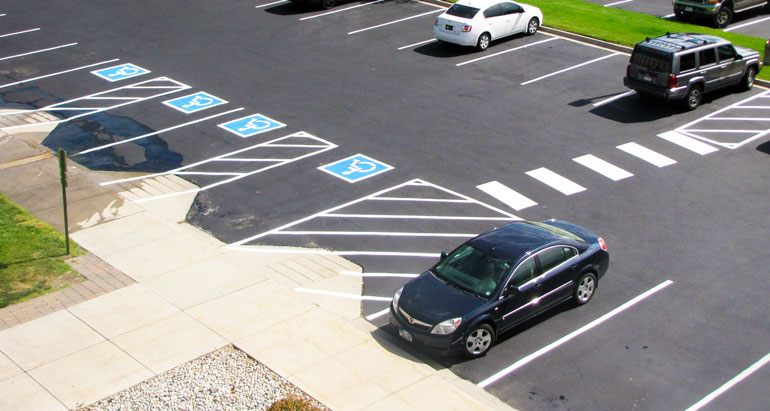 Pavement markings for disabled parking spaces