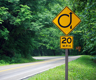 Slow down when going through a curve