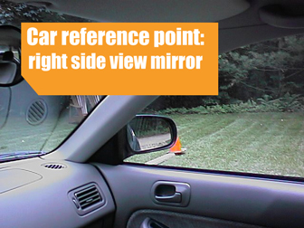 Right side-view mirror as a reference point for a stop line