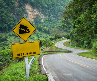 Use lower gears when traveling downhill and uphill