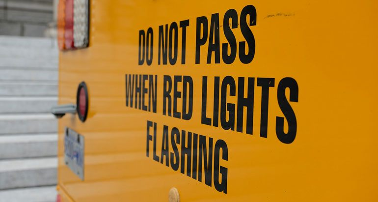 Stop When Red Lights on The Bus Are Flashing