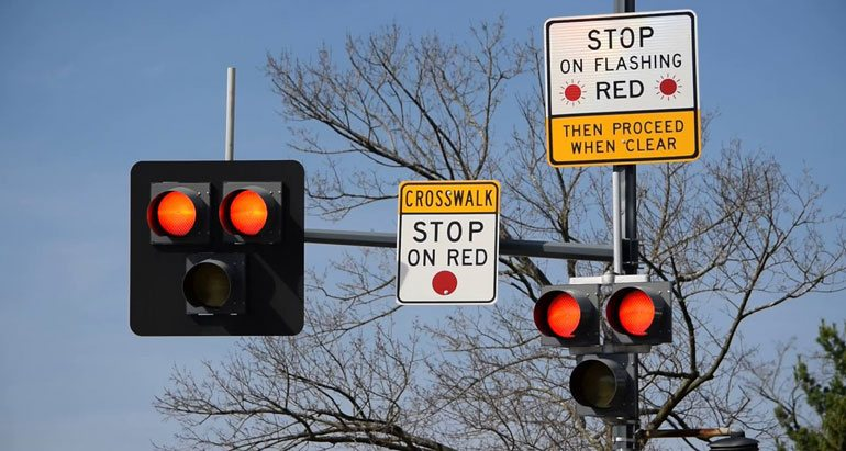 Stop at crosswalk on red signal
