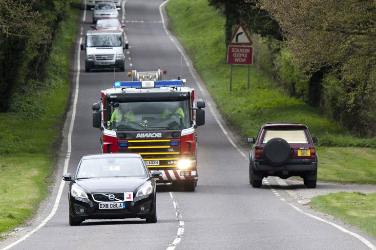 Give right-of-way to emergency vehicles approaching from the front